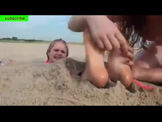 More beach tickling, except this girl has nicer feet and a cuter laugh.