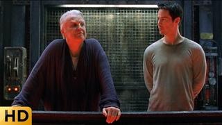 Нео и советник Хаммонд гуляют на техническом этаже. Матрица: Перезагрузка.