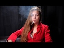 Lady in red Ksenia is smoking sitting on the sofa