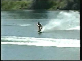 Water skiing freestyle tricks on slalom