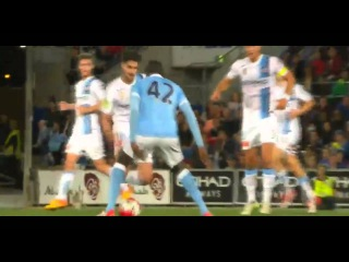 Paulo Retre (Melbourne City) nutmegs Manchester City's Yaya Toure