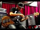 Miki Santamaria slapping a Wal bass with EBS amps