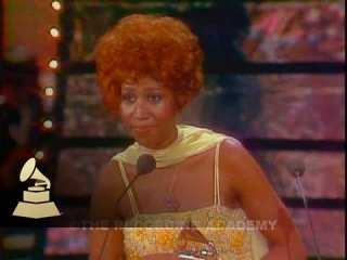 Aretha Franklin accepting the GRAMMY for Best Female R&B Vocal Performance from David Bowie