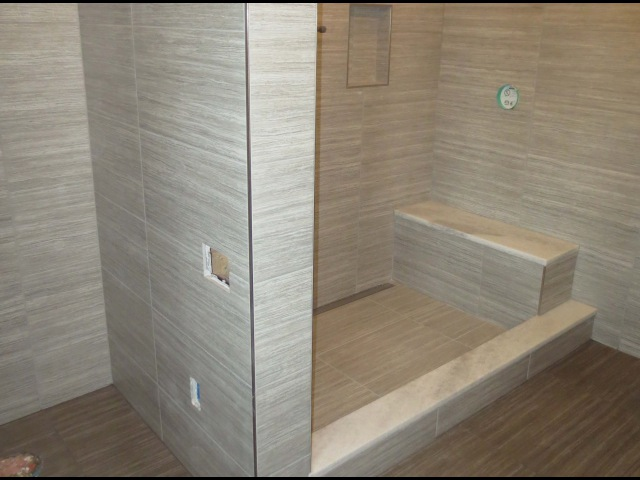 Start to finish Time lapse Schluter bathroom Kerdi line linear drain Ditra heat large format tile.