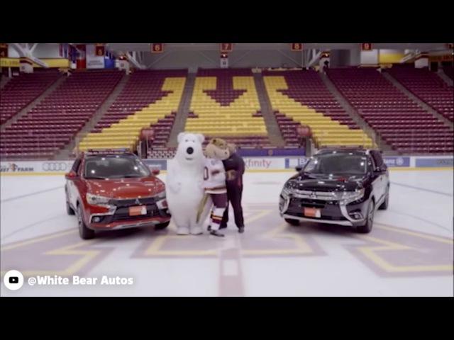 Polar bear mascot keeps slipping over on the ice