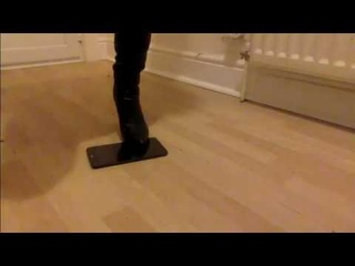 Tablet Crushed in Stiletto Boots