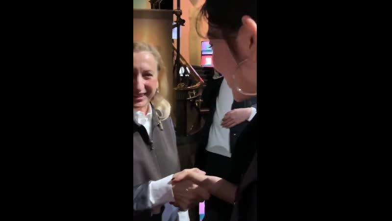 Irene shaking hands with Miuccia Bianchi Prada the head designer of Prada and founder of its subsidiary Miu Miu last year in Pa