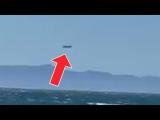 Huge black UFO spotted over the sea Channel Islands